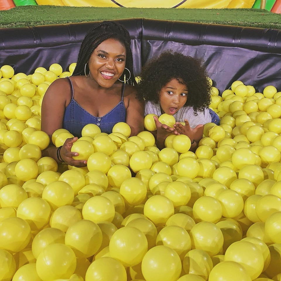 big and little sister in a bubble pit