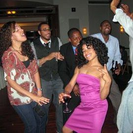 women and men dancing on the dance floor at a big sister boston event